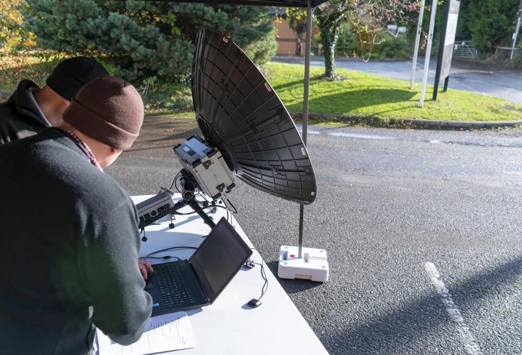 Engineers testing a Tampa Manpack Satellite Terminal
