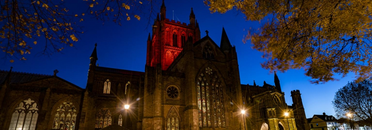 Hereford Cathedral illuminated in red for Remembrance Day