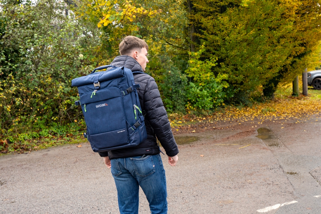 Satcube, batteries, power cables and more all packed into a backpack