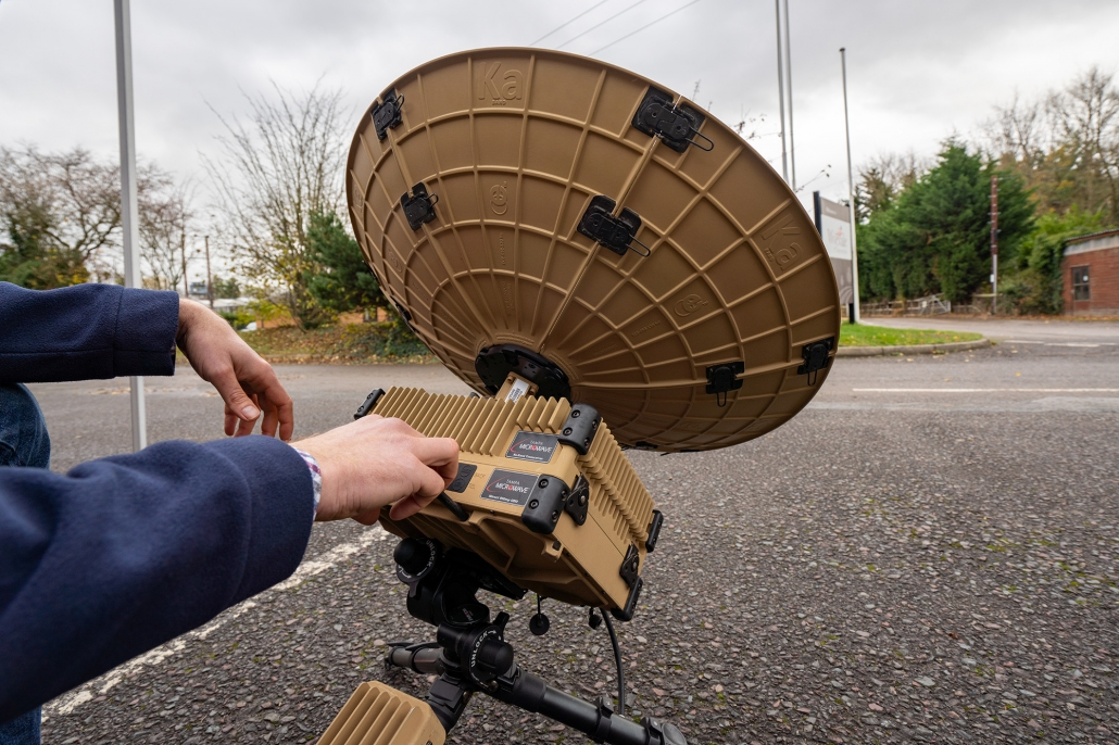 User setting up a Tampa Microwave Manpack 65